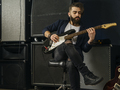 Bearded man playing an electric guitar in a studio - PhotoDune Item for Sale