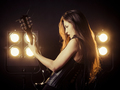 Sexy woman playing electric guitar on stage - PhotoDune Item for Sale
