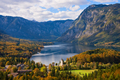 Boat on Bohinj Lake in an autumn landscape - PhotoDune Item for Sale