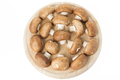 Group of brown mushrooms on a cutting board. Located on a white background. - PhotoDune Item for Sale
