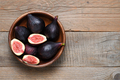 Fresh figs in wooden bowl top view - PhotoDune Item for Sale
