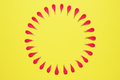 Circle of red floral petals on yellow background - PhotoDune Item for Sale