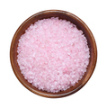 Pink sea salt in wooden bowl for spa and bath isolated on white background - PhotoDune Item for Sale