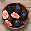 Ripe figs in wooden bowl close-up - PhotoDune Item for Sale