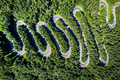 Aerial view of a winding road in green forest by drone - PhotoDune Item for Sale