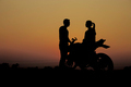 Couples with a motorcycle at sunset - PhotoDune Item for Sale