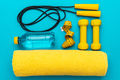 Flat Lay Photo Of Yellow Fitness Equipment In Oder Over Turquoise Blue Backgound - PhotoDune Item for Sale