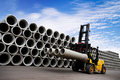 Stacked Concrete Pipes and Forklift - PhotoDune Item for Sale