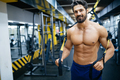 Man training with TRX Suspension at fitness club - PhotoDune Item for Sale