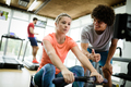 Young beautiful woman doing exercises with personal trainer - PhotoDune Item for Sale
