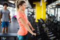Young beautiful woman doing exercises for biceps - PhotoDune Item for Sale