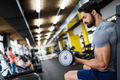 Determined male working out in gym - PhotoDune Item for Sale