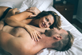 Romantic couple in bed during sexual foreplay - PhotoDune Item for Sale