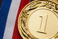 Close-up of a golden medal for the number one - PhotoDune Item for Sale