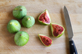 Figs and knife on wooden chopping board - PhotoDune Item for Sale