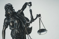 Statue of Justice holding aloft scales - PhotoDune Item for Sale