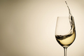 Suspended drops and splash of white wine in glass - PhotoDune Item for Sale