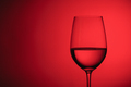 Glass of wine over a red background - PhotoDune Item for Sale