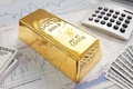 Gold bullion bar on a stocks and shares chart - PhotoDune Item for Sale
