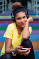 Pretty young black african american woman listening to music wit - PhotoDune Item for Sale
