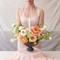 Woman holding vase full of flowers. - PhotoDune Item for Sale