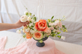 Woman hands touching  a bouquet of flowers. - PhotoDune Item for Sale