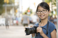 Girl photographer with digital camera - PhotoDune Item for Sale