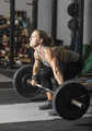 Strong young female weight lifter doing heavy deadlift. - PhotoDune Item for Sale