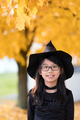 Portrait of little asian girl in witch costume - PhotoDune Item for Sale