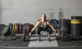 Strong woman preparing to lift heavy barbell in gym. - PhotoDune Item for Sale