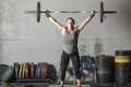 Strong woman with heavy barbell over her head. - PhotoDune Item for Sale