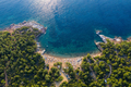 Aerial drone view of beach umbrellas and sunbeds on the coast in Thassos island, Greece - PhotoDune Item for Sale