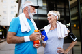 City running couple jogging outside. Senior couple runners training outdoors - PhotoDune Item for Sale