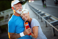 Healthy senior, couple jogging in the city at early morning with sunrise - PhotoDune Item for Sale