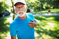 Mature man exercising outdoors to prevent cardiovascular diseases and heart attack - PhotoDune Item for Sale