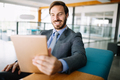 Young handsome business man using a digital tablet at office - PhotoDune Item for Sale