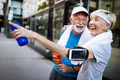 Fitness, sport, people, exercising and lifestyle concept - senior couple running - PhotoDune Item for Sale
