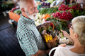 Senior family couple choosing bio food fruit and vegetable on the market during weekly shopping - PhotoDune Item for Sale