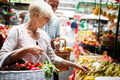 Mature woman buying vegetables at farmers market - PhotoDune Item for Sale