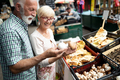 Mature couple shopping vegetables and fruits on the market. Healthy diet - PhotoDune Item for Sale