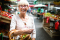 Only the best fruits and vegetables. Beautiful mature woman buying fresh food on market - PhotoDune Item for Sale