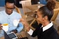 Black  African American coworkers doing digital teamwork arround - PhotoDune Item for Sale
