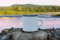 White campfire enamel mug mockup with sunrise river view - PhotoDune Item for Sale