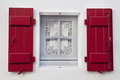 Red shutters and vintage window on a French facade - PhotoDune Item for Sale