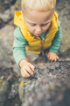 Toddler boy playing on a rock - PhotoDune Item for Sale