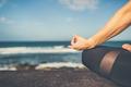 Yoga girl meditating and relaxing in yoga pose, ocean view - PhotoDune Item for Sale