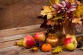 Fall centerpiece with purple flowers, golden pumpkin - PhotoDune Item for Sale