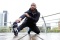 Fit and sporty young man doing stretching in the city. - PhotoDune Item for Sale