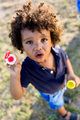 African american baby blowing soap bubbles in the park. - PhotoDune Item for Sale