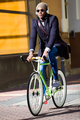 Handsome young man riding a bike in the street. - PhotoDune Item for Sale